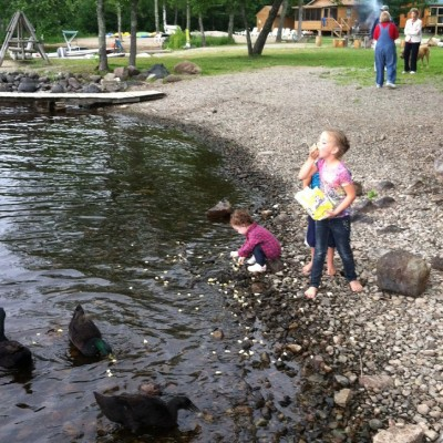 Bella feeding the ducks and herself.